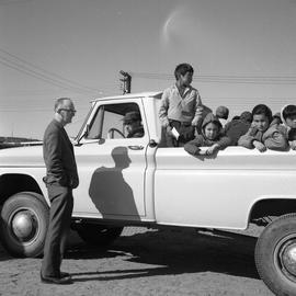 Photograph of a pickup truck with several children in the back in Fort Chimo, Quebec