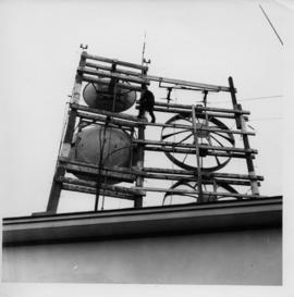 Photograph of a person standing on an unidentified radio tower
