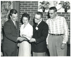 Photograph of four people at miscellaneous health-related event