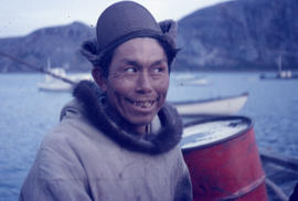 Photograph of a man with a tan parka and brown hat in Newfoundland and Labrador