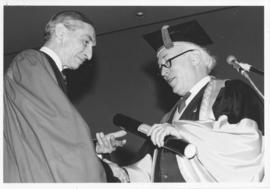 Photograph of Dr. L. C. B. Gower receiving an honorary degree
