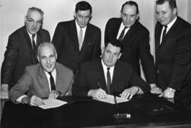 Photograph of Maritime Telephone & Telegraph signing draft collective agreement with the IBEW