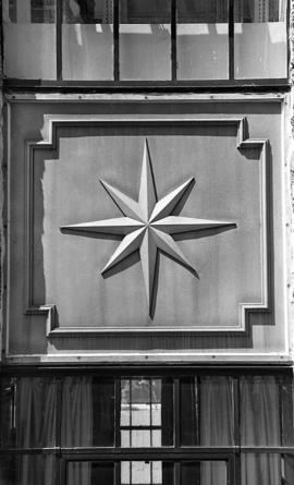 Photograph of a metal star on a building