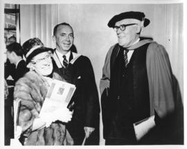 Photograph of Lady Dunn smiling with two unidentified people