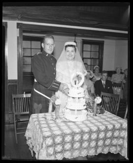 Photograph of Mr. & Mrs. Leil cutting the wedding cake