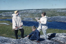 Photograph of two women and a boy on the tundra in Fort Chimo, Quebec
