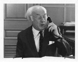 Photograph of Henry Hicks speaking on the phone