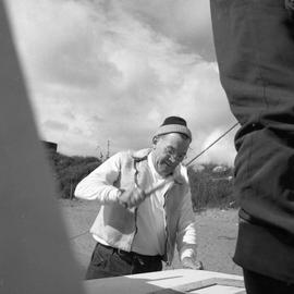 Photograph of Bill Walker hammering a nail in Fort Chimo, Quebec