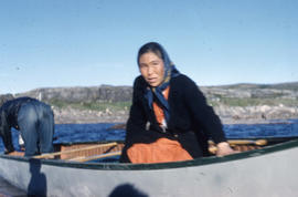 Photograph of an unidentified woman in a canoe in Fort Chimo, Quebec