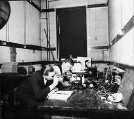 Photograph of a men in a chemical research laboratory in the Science Building
