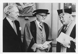Photograph of Henry Hicks and two unidentified people in academic dress