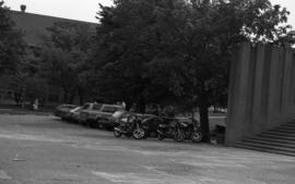 Photograph of vehicles parked in front of the Killam Memorial Library in 1988