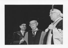 Photograph of Henry Hicks, Dr. A. J. Tingley, and Dr. Mackenzie at a convocation ceremony