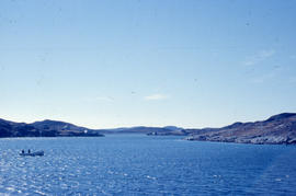 Photograph of a small boat on the water near Newfoundland and Labrador