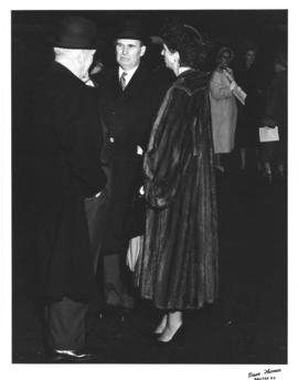Photograph of E. C. Plow and Lady Dunn talking to an unidentified man
