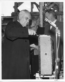 Photograph of C. D. Howe at the laying of a cornerstone for the men's residence