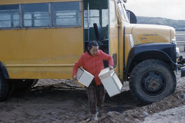 Photograph of a young woman and a bus in Frobisher Bay, Northwest Territories