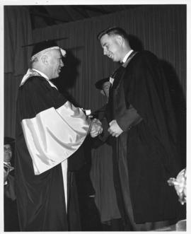 Photograph of Henry Hicks conferring a degree on Arthur McDonald