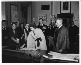 Photograph of Princess Elizabeth signing a guest book in the Macdonald Memorial Library