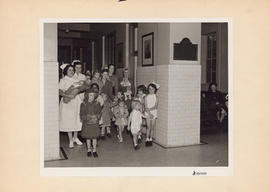 Photograph of children and nurses in Outpatient and Public Health Clinic