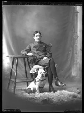 Photograph of Clarence McDearmid and a dog