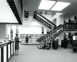 Photograph of the Circulation Desk and staircase in the W.K. Kellogg Library