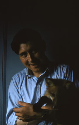 Photograph of George Koneak holding a fox