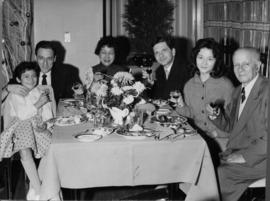 Photograph of Klaus Pringsheim and others at a table