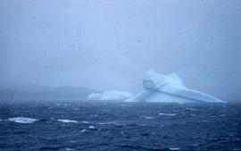 Photograph of an iceberg in a storm near Cape Dorset, Northwest Territories