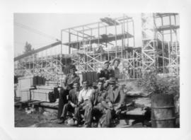 Photograph of a group of men at the construction site of the Arts & Administration Building