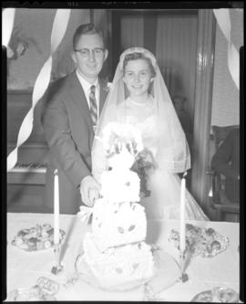 Photograph of Mr. & Mrs. Grice cutting the wedding cake