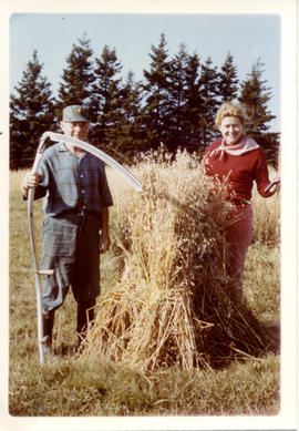 Photograph of Barbara Hinds and an unidentified man with a wheat sheaf
