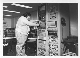 Photograph of an unidentified person with a switchboard