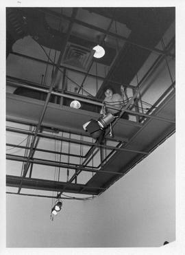 Photograph of an unidentified person setting up lights