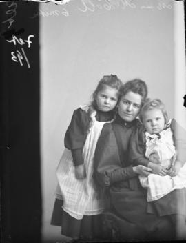 Photograph of Miss Annie McColl and two children