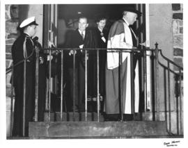 Photograph of E. C. Plow, Lady Dunn, and others exiting a building