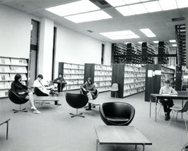 Photograph of the first floor stacks and reading room in the W.K. Kellogg Library