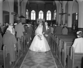 Photograph of Mr. & Mrs. Wright walking down the aisle at their wedding
