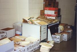 Photograph of piles of files and boxes