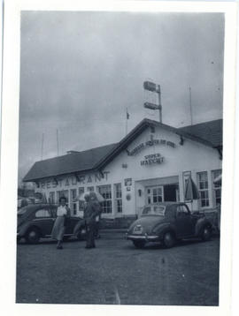 Photograph of Maureen Beren and Thomas Head Raddall outside the Pou du Ciel Inn in Belgium