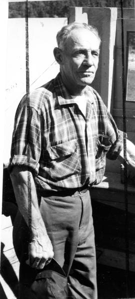 Photograph of an unidentified man wearing a plaid shirt