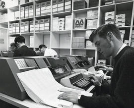 Photograph of people working on computers at the Dalhousie Computer Centre
