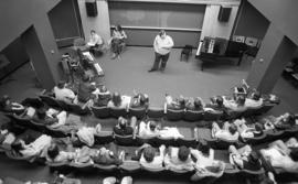 Photograph of an unidentified person giving a lecture to a music class