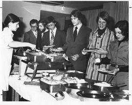 Photograph of guests lined up at a buffet