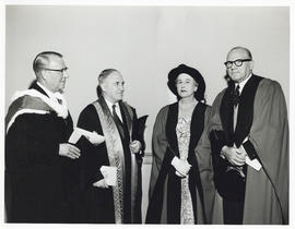 Photograph of A.E. Kerr with faculty members at convocation
