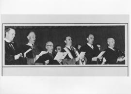 Photograph of people singing at a convocation ceremony