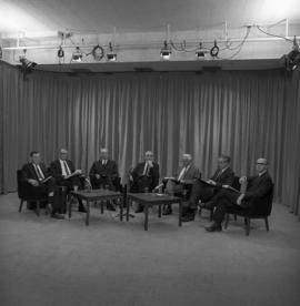 Photograph of a panel of seven unidentified people