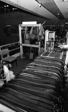 Photograph of a stand selling leather goods at a craft market