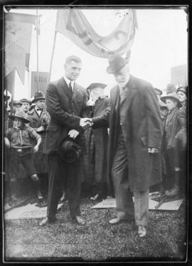 Photograph of Dr. K.A. Allison handing over the dedication tablets from the old college to Studen...