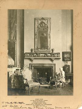 Photograph of Harris Brown sitting by a fireplace